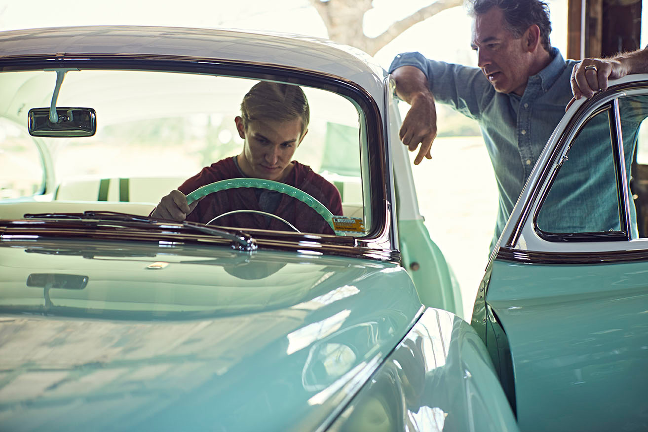 Father and son enjoying classic car