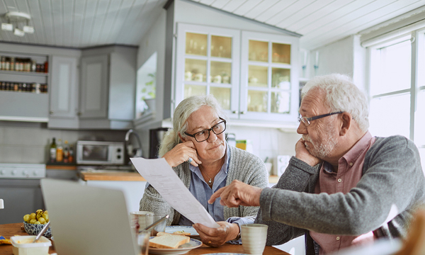 Elderly couple working on paperwork together