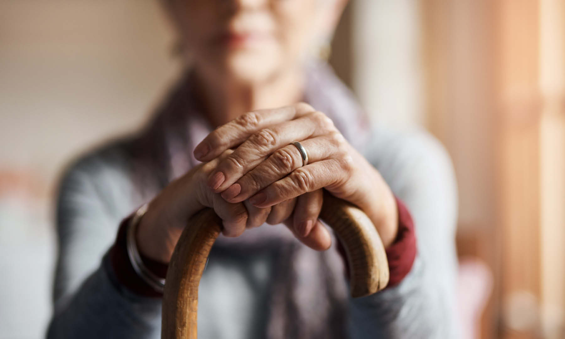 Elderly woman holding a cane
