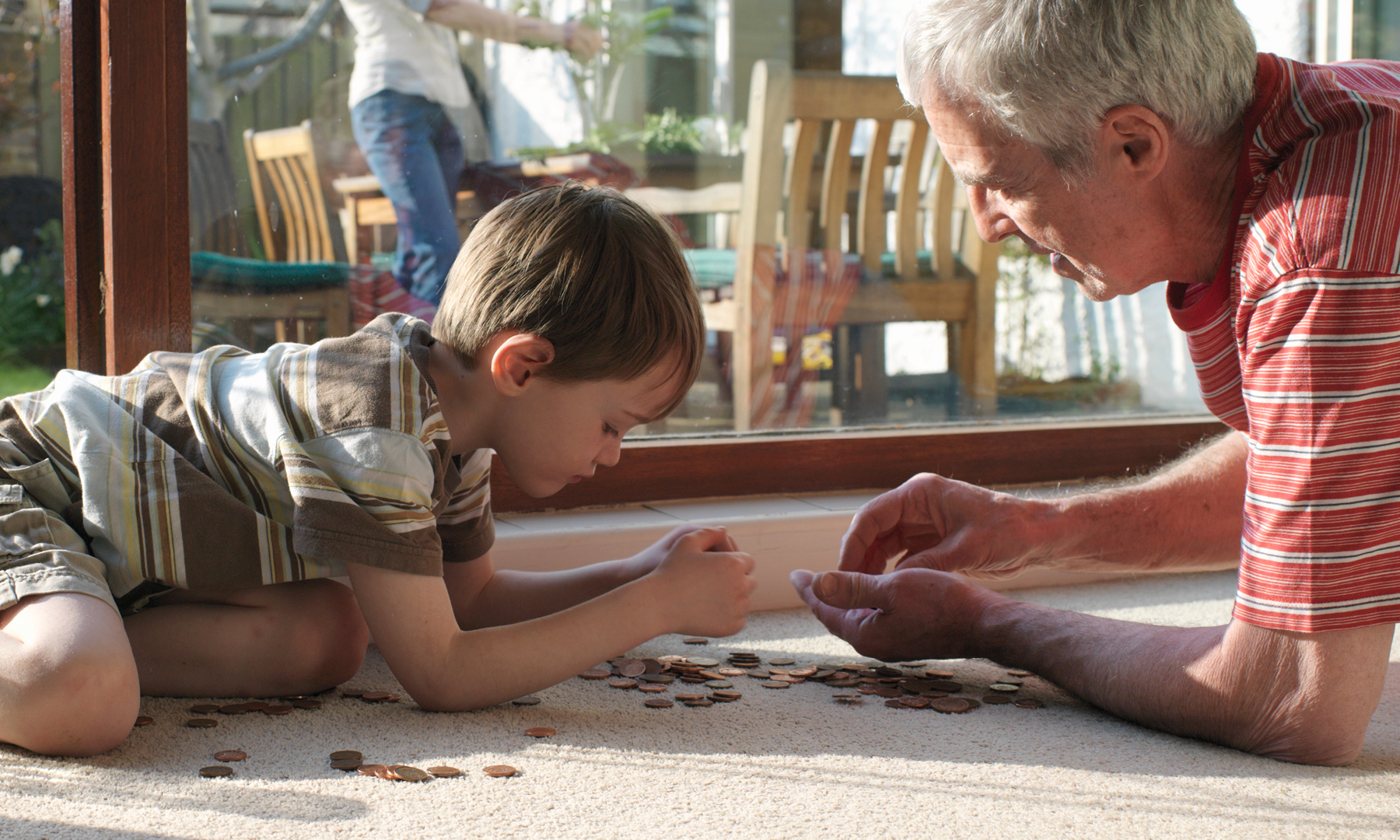 Young boy playing with grandpa