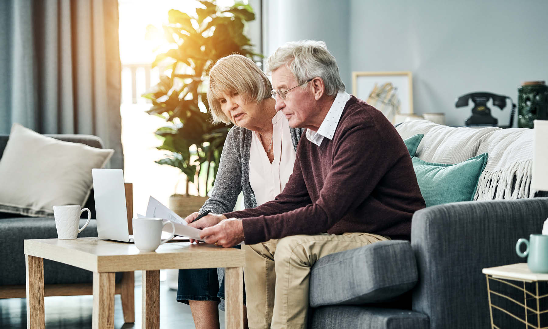 Elderly couple reviewing finances